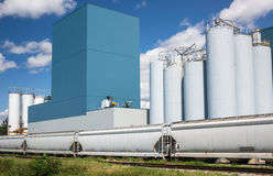 VBC Bryan Tombstone industrial-plant-silos-against-blue-sky-33138319